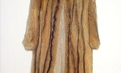 Beautiful Full length Raccoon Fur coat. Bought for over $1000.00 and used only a few times. Looks new. Size 10. Comes with a zip cloth bag for protection. Price negotiable.