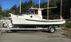 Year 2000 only 414 hours on a 3 cyl Yanmar diesel. Was used in a lake and only has 50 hours of saltwater use. Comes with a full stand up awning plus a cockpit cover for storeage, has the mast and boom option, factory ordered custom interior with 2 swivel