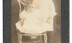 Rare early 20th century black & white photo of Kingston girl and her baby sister. Photo is mounted on thick cardboard and was made by J.F. Lochead Photographers of Kingston, On. My research found that J.F. Lochead was at this address in Kingston between