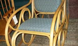 Rattan Rocking Chair with Footstool in excellent condition for $80.00