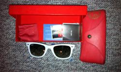 Collectors Edition Raybans. Paid 160$ from sunglasses hut only asking 70$. Comes with all papers to show their legitimate. Call me at (519)331-3193
