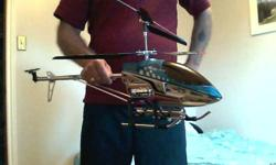Used Skyking RC Helicopter 8501 (GYRO) Blue. Brand new blades with transmitter. 35'' In Length.