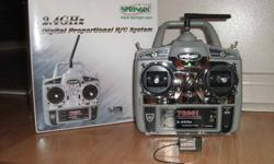 Selling 1 Spring transmitter and receiver for a fixed wing R/C plane --- NOT FOR HELICOPTERS This Item is brand-new never used was bought by mistake for heli.