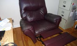 burgundy nagahyde recliner in very good condition