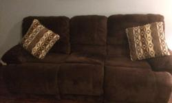 Excellent condition 1 year old 3 seat reclining sofa and 2 seat reclining love seat with storage compartment and drinks holders for sale , Brown suede like fabric as new scotch guarded at time of purchase. Extremely comfortable. Reason for selling -