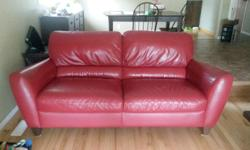 Vibrant Red Leather Couch. Well taken care of. Good condition, small blemish on side of arm from moving. Sad to let it go but no longer matches décor after a move. Willing to negotiate price. Please call or text 306-551-3966 for more information or to