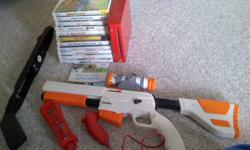 Comes with one red controller, and nunchuck. Games: Super Mario Galaxy Wii Sports Super Smash Bros: Brawl NHL Slapshot - New Wayne Gretzky Game With Hockey Stick Reel Fishing:Anglers Dream Animal Crossing City Folk Sim Animals Lego Indiana Jones Game