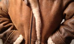 This is an awesome sheepskin leather US armed forces aviator jacket purchased on E-Bay 3 years ago for $450 but never warn as jacket is too small for me. Been hanging in a closet and should go to good home for someone who wants a great looking jacket for