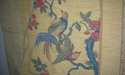 """Made in France, 100% cotton quilted, 28"""" by 28"""", 3 tasels, depicts 2 birds in branches."""