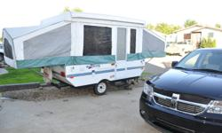 Lots of features that includes 3-way fridge, furnace, sink and small water tank, awning, 2 burner inside/outside stove, electric brakes, battery and propane tank. Sleeps six. Has water and power hook up. No leaks.
