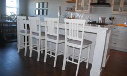 Beautifully refinished counter height stools with fabric seats. The stools are painted in antique white melamine paint which is very hard wearing. The seats have been re-upholstered with a soft grey fabric which would go with any decor. Height to the top