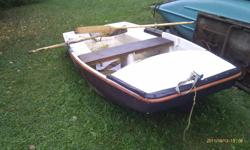comes with paddles.  (heavy, but unsinkable)