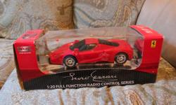 Official Licensed Ferrari Remote control. Model Enzo Ferrari. Scale 1:20. Rechargeable battery and charger included . Excellent condition. Only used a few times. Must pick-up.