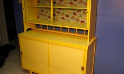2 toned yellow hutch with fun pie fabric backing. Pickup only, Orleans. Total height 58.5 inches 48 inches wide 18 inches deep cabinet height 31.5 inches upper cabinet 27 inches