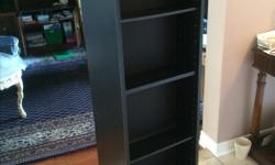 Tower shaped revolving shelving unit On a turnstile, turns easily, no grating sounds etc. Can place items on multiple shelves on both sides Depth of items which can be placed: 6 inches Many shelves and pegs are available for meeting specific shelving