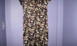 Brown/Beige/White Dress - Lined Brand - Rickis Size: 8 In new condition Can be worn as casual and/or dressy 97% Polyester 3% Spandex Lining 100% Polyester $15 AWESOME!! Can meet in west end of ottawa (kanata) or pickup in Constance Bay