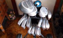 Right hand golf clubs, 1 wood - Mr. Big, 3 & 5 wood - Northwestern, 3 4 5 6 7 8 9 pitching and sandwedge - Big Bursar irons, 2 putters, ball caddy, golf bag, pull cart.