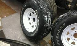 p235 70r 15in tires on white rims fits chevy 1/2ton truck or van 5 bolt 10,000ks on tires rims new in oct 2011 tires new aug 2010 have bills to show tires bridgestone duellers price neg . have all four to match