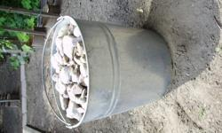 """Landscape river stones. 5 BAGS in bucket measure as shown 11""""H 11""""Dia. 1 BAG $15 I will need help to move the bags from back yard."""