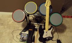 Rock band for xbox 360 comes with every thing you need to rock out it works great and is only a couple moths old and was only used a couple of times.