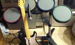 Great condition and fully functional Selling as they?ve been replaced with electrical drums   Rock Band Drum Kit Includes: drums  & sticks, rockband microphone, guitar & PS3 Beatles game   Asking $150 or BO (Huntsville)   Happy Holidays