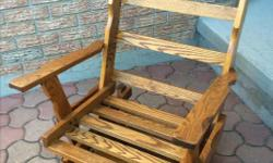 Quality Rocking Chair Superb construction, very solid Clean The wood is in perfect condition, no sign of wear, rot or scratches First pic shows without seat covers, second pic shows with existing seat covers. With 4 small round floor cushions to protect