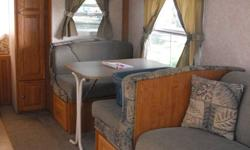 2006 Rockwood Roo 21SS expandable with a huge slide!  ·        Weighs only 3800 pounds ·        Sleeps 7 when both queen beds are expanded (heated mattresses) ·        Dinette and sofa convert as well to provide extra sleeping space ·        Kitchen