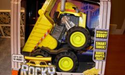 "Matchbox Rocky the Robot Dump Truck Interactive Motion Sensor Motorized Movement 15"" Long Dances; Dumps & Talks Batteries Included Brand New & Sealed"