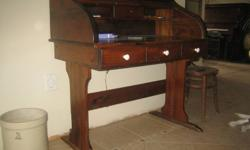 """Walnut finish roll top desk. 48""""wide x 48""""tall x25""""deep. Good condition, about 35 years old."""