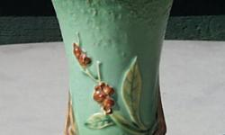 Roseville Pottery Vase This is a classic example of a vase by the famous Roseville Pottery. There's a tiny chip in the rim. I'm told that, because their pottery was so soft, chips weren't uncommon in Roseville vases. Notwithstanding, because of this tiny