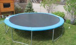 Round Trampoline, 14-ft diameter in mint condition, bought at Canadian Tire. Safety pad was replaced at Canadian Tire. Safety enclosure is worn out, but still can be used. It also can be replaced at Canadian Tire. For more information about this