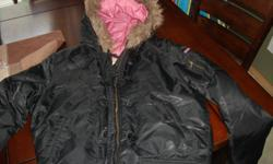 womens medium Roxy winter coat. Black with a fur ring on the hood, pink on the inside..$45