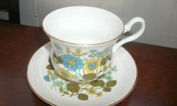 Beautiful blue/green floral pattern.  Over 30 years old.