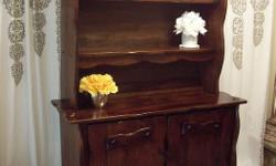 I have a beautiful rustic red oak (real thick canadian oak wood) cabinet with hutch for sale. Very chic piece. In excellent condition. Has beautiful carving detail. The cabinet has a removable shelf on each side. The top hutch is removable for easy