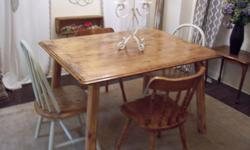 I have a beautiul rustic large harvest dining table set for sale. Made of pine. The table has beautiful distress detail in the wood. The set also comes with 2 sets of chairs. One set is red oak the other set is a shabby chic light green set. The