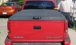 ARE Hard Top Tonneau Cover from Chev S 10 Sportside truck. Inside frame measurements, 74 inches long by 52 1/2 inches wide. Lock in working condition with key.