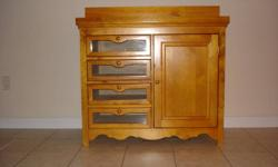 Solid pine (honey stain) crib and armoire/change table for sale.  A few teeth marks scratch the foot board as seen on a picture.   Cib has three levels, perfect during baby growth.  Then remove the front gate to convert crib into a day bed.   There's