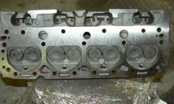 A pair of SBC cylinder heads. 441 casting #. They are fresh from machine shop and ready to bolt on. Multi-angle valve job, Comp springs, surfaced etc. No port work. Originally from a '69 350 2bbl. $450.