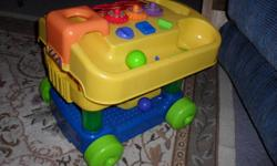 Lots of play value from toddler to three.  Teaches shapes and has things child can twist, turn and pick up.  Ask for Cindy or Frank. I also have a folding stroller in excellent condition for $20.00.