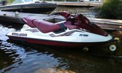 White and burgundy, oil injected, has always sat on a lift out of the water. Comes with cover. Roughly 20 hours on fully rebuilt motor...great running machine. Call Jamie 416-358-2909 or e-mail jamieelectric@gmail.com.