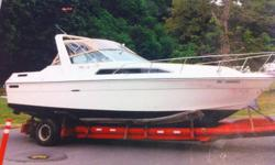 27' Searay sundancer, 10' beam, twin merc 260hp. - Runs good - Some spare parts - Teak and blue carpet interior - Sleeps 6 - used for fishing and overnighting -