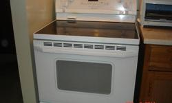 White Whirlpool Gold series top of the line 30? Self-Cleaning oven with smooth black Ceran top, high power radiant elements, ?Accu Bake? even heating system, electronic controls and fluorescent work surface lighting. Stove is spot-less and includes