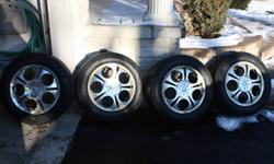 4 Pirelli Snow tires on sport rims; Rims are a universal fit, good condition Pirelli Winter tires 215/60R16 99H Tires were used for 4 winters, are in good condition and have a few more winters left. Were on a 2007 Nissan Altima which we just traded in.