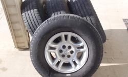 Set of 4 Dodge Mag wheels AND tires. 3/16 tread left above wear bar, so lots of life left. P265/70 R 16