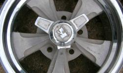 """Rims are in good shape, 1 center cap broken, 1 missing and 1 different, all need a good cleaning but would look great on your old car. Rims are 14"""" diameter x 6"""" wide and 4 3/4"""" bolt pattern. Rims come with goodyear bias tires, sizes are G70-14 (2 of"""