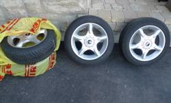 Mini Cooper Wheels: 195/55/16.  5-spoke design.  Goodyear eagle winter runflats currently on rims.50% tread left on 2 of the wheels, the others would need to be replaced.  Priced for quick sale.  No emails please.