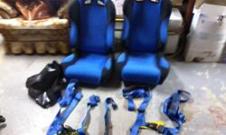 hey i have a set of blue and black racing seats for sale no rips or tears in very good condition also comes with 2 4 point racing harnesses 500 dollars for everything or trade for something car related email or text 305-4126 thanks