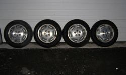 Set of four aluminum chevy rims with 225/60r16 tires mounted on them, tread is decent and should pass safety no problem. asking $120.00 for the set of 4 rims and tires.
