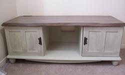 I have a shabby chic beige tv stand for sale. Its an all purpose decorative piece. Has a beautiful multitone finish on the top. Has lots of storage space on the bottom and is very sturdy so it can be used as a large TV stand or as a bench/chest. In good