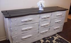 "I have a shabby chic large black and white dresser chest for sale. Made of solid oak. It is in excellent condition. Has 6 wide spacious drawers and 3 smaller ones with beautiful detail. All the drawers are clean and slide well. Dimensions are 75"" long x"